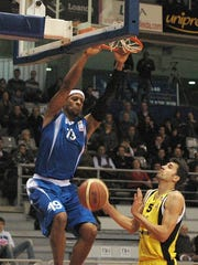 Opelousas native Mildon Ambres (left) is shown in 2010 playing for CE Lleida Bàsquet in The Liga Española de Baloncesto in Catalonia, Spain.