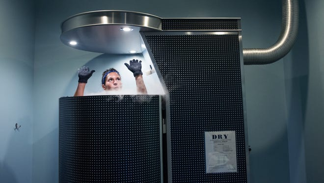 Hala Sufi undergoes a full-body cryotherapy session at Ice Up Cryo in Knoxville on Oct. 8, 2015. Cryotherapy is a new treatment option for those who routinely use ice to relieve or diminish pain.