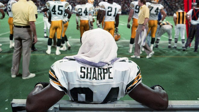 Green Bay Packers receiver Sterling Sharpe (84) sits on the bench late in the game against the Minnesota Vikings at the Metrodome in Minneapolis on Dec. 27, 1992. Sharpe had six catches in the game, giving him 108 for the season and breaking the single-season record of 106 set by Washington's Art Monk in 1984.