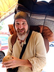 Monty Python fan Jeff Hart, carrying coconuts for sound