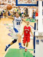 DAVID ALBERS/STAFF- Florida Gulf Coast University's Chase Fieler dunks against Hartford in the second half of the Breakfast at the Beach game at Alico Arena on Tuesday, Nov. 12, 2013, in Fort Myers.