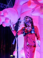 Wayne Coyne of The Flaming Lips welcomes the audience during a performance at the Farm Bureau Insurance Lawn at White River State Park in Indianapolis on Tuesday, Sept. 19, 2017.
