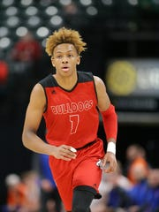 New Albany guard Romeo Langford (1) heads down court