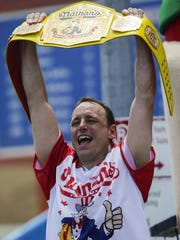 Joey Chestnut celebrates after winning the annual Nathan's