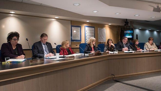 Superintendent Andrea Oquist and Livonia school board trustees Mark Johnson, Dianne Laura, Colleen Burton, Tammy Bonifield, Dan Centers, Eileen McDonnell and Liz Jarvis prepare to vote.
