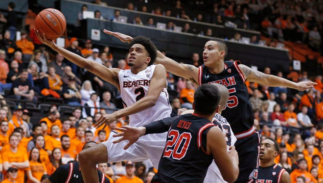 Oregon State's Stephen Thompson Jr. (2) drives past Utah's Dakaria Tucker (14), Chris Reyes (20) and Lorenzo Bonam, right, during the first half of an NCAA college basketball game in Corvallis, Ore., on Thursday, Feb. 4, 2016.