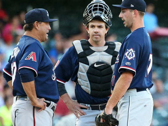 Reno Aces pitcher Nick Baker, right, talks with pitching