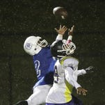 Woodward's Will Coker tries to catch a pass against Aiken Friday.