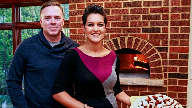 Patrick and Synara Brown have become adept a making pizzas in the wood -fired oven in their Wauwatosa home.