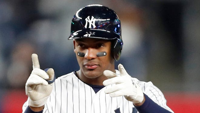 New York Yankees Miguel Andujar (41) gestures toward the dugout after hitting a double in the sixth inning in the Yankees' 14-1 win over the Twins.