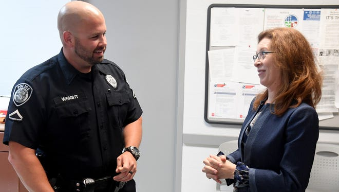 Jackson Police Officer Lance Wright talks with Western Governor's University Chancellor Dr. Kimberly K. Estep after Wright was awarded a $10,000 scholarship, Wednesday, May 16.