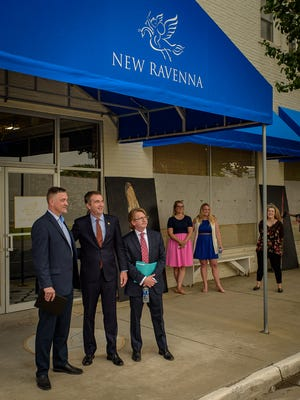 Alex Potchatek, Gov. Ralph Northam and Richard Walters pose for pictures in front of the New Ravenna building in Exmore, Virginia on Friday, June 1, 2018.