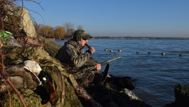Bob Soulliere calls ducks from a rocky point on Lake St. Clair.