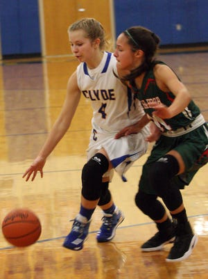 Clyde's Heidi Marshall is defended by Oak Harbor's Sophie Eli.