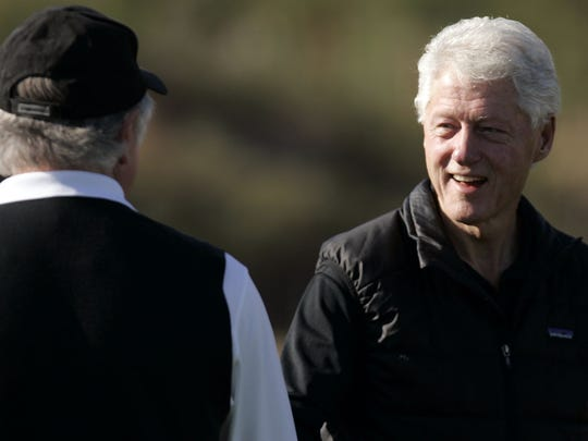 Former President Bill Clinton greets people on the driving range at PGA West on Thursday, January 19, 2012 during opening day of The Humana Challenge at in La Quinta.