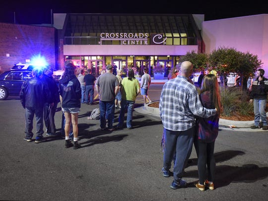 People gather at an entrance to Crossroads Center Sept.
