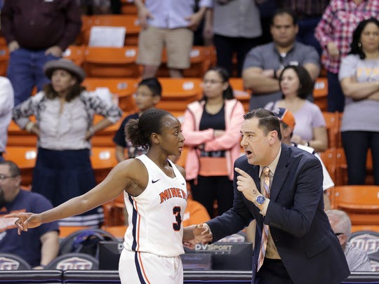 UTEP head coach Kevin Baker conspires with forward