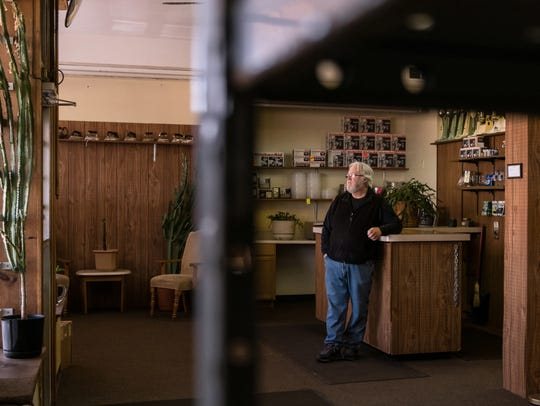 McNichols Electric co-owner Pat Kehoe waits in his shop's lobby for customers on Monday, March 19, 2018. The business, which once had four local stores, is now down to a single shop.