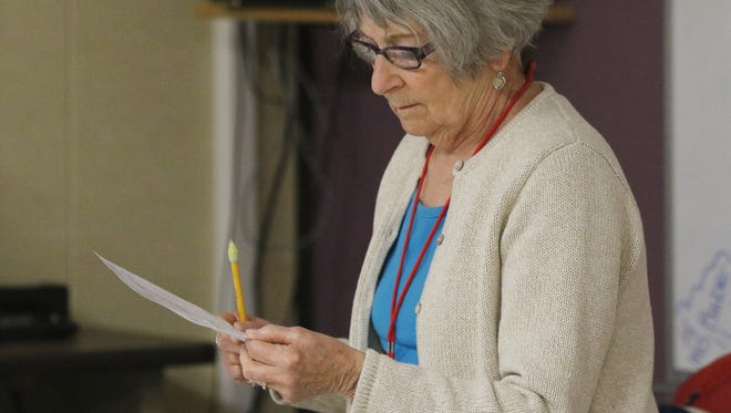 Cindy Nepper looks over a list of students while she substitute teaches an algebra class at Lincoln High School in Wisconsin Rapids, Thursday, May 19, 2016.