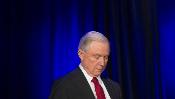 Attorney General Jeff Sessions bows his head in prayer