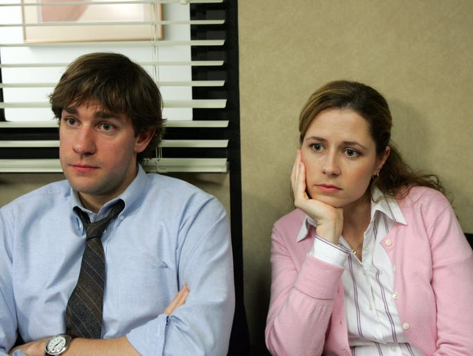 """Pam Beesly (right), played by Jenna Fischer, on the television sitcom """"The Office"""" is initially the receptionist at the paper distribution company Dunder Mifflin, before becoming a saleswoman and office administrator."""