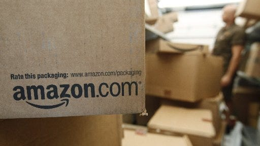 This Oct. 18, 2010 file photo shows an Amazon.com package on a UPS truck in Palo Alto, Calif.