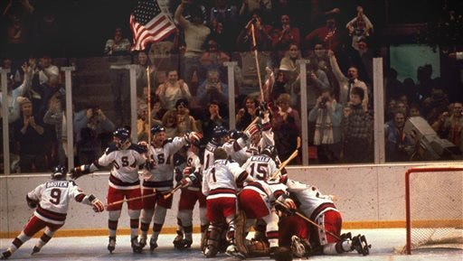 In this Feb. 22, 1980, file photo, the U.S. hockey team pounces on goalie Jim Craig after a 4-3 victory against the Soviets in the 1980 Olympics, as a flag waves from the partisan Lake Placid, N.Y. crowd. It's been more than three decades since his landmark goal became the centerpiece of the U.S. Olympic hockey team's Miracle on Ice. For 60-year-old Mike Eruzione, it still seems like only yesterday.