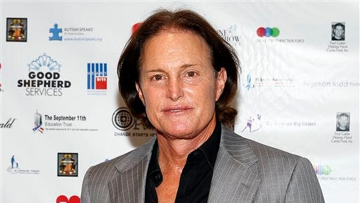 In this Sept. 11, 2013, file photo, former Olympic athlete Bruce Jenner arrives at the Annual Charity Day hosted by Cantor Fitzgerald and BGC Partners, in New York. Jenner made his debut as a transgender woman on the cover for the July 2015 issue of Vanity Fair. The image was shot by famed celeb photographer Annie Leibovitz.