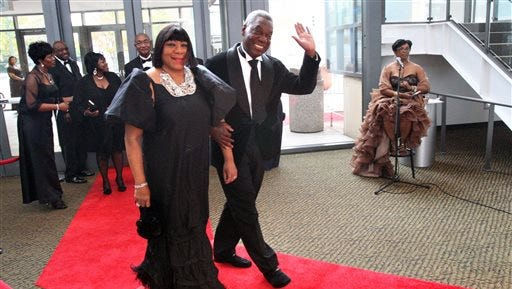 This Nov. 12, 2011, photo shows Adrienne Bailey and her husband Judge D'Army Bailey, civil rights activist and a founder of the National Civil Rights Museum, walk on the red carpet as they arrive with other dignitaries and guests to the 2011 Freedom Awards at the Cannon Center for the Performing Arts in Memphis. Bailey, a lawyer and judge who helped preserve the Memphis hotel where civil rights leader Martin Luther King Jr. was assassinated and turn it into National Civil Rights Museum, died on Sunday, his wife said. He was 73.