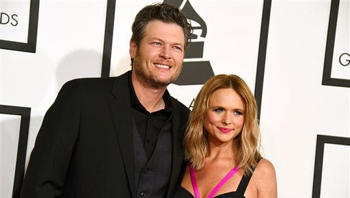 FILE - In this Feb. 8, 2015 file photo, Blake Shelton, left, and Miranda Lambert arrive at the 57th annual Grammy Awards in Los Angeles. Shelton and Lambert announced their divorce after four years of marriage. Shelton's spokesman provided a statement from the couple on Monday, July 20, 2015. (Photo by Jordan Strauss/Invision/AP, File)
