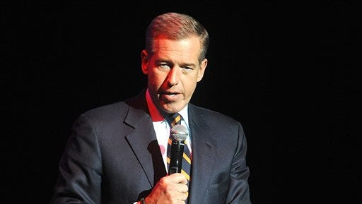 FILE - In this Nov. 5, 2014, file photo, Brian Williams speaks at the 8th Annual Stand Up For Heroes, presented by New York Comedy Festival and The Bob Woodruff Foundation in New York. Williams will return to the air following his suspension on Sept 22, 2015, as part of MSNBC's coverage of Pope Francis' visit to the United States. (Photo by Brad Barket/Invision/AP, File)