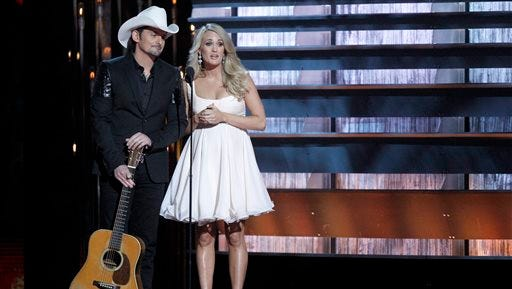 FILE - In this Nov. 5, 2014 file photo, hosts Brad Paisley, left, and Carrie Underwood appear at the 48th annual CMA Awards in Nashville, Tenn. The pair return to host another CMA Awards event, Wednesday, Nov. 4, 2015, which includes three days of rehearsals.  (Photo by Wade Payne/Invision/AP, File)