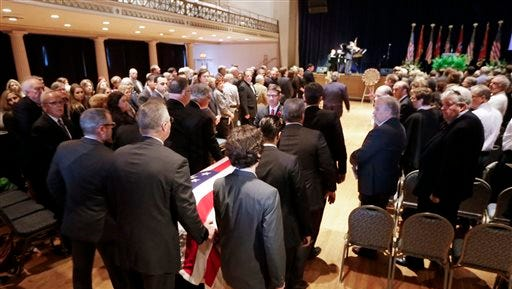The casket is brought into the War Memorial Auditorium during a funeral service for Fred Thompson, a former United States senator, actor and Republican presidential candidate, Friday in Nashville.