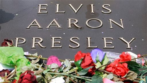 In this Aug. 16, 2007 file photo, the grave of Elvis Presley is covered with flowers on the grounds of Graceland in Memphis on the anniversary of his death. Graceland, where Presley lived, is a top Memphis attraction.