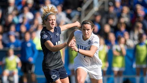 Duke's Taylor Racioppi (7) and Penn State's Emily Ogle (10) fight for the ball during the first half of the NCAA Women's College Cup soccer final in Cary, N.C., Sunday, Dec. 6, 2015.