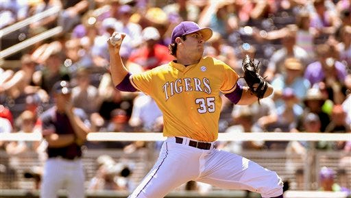 LSU pitcher Alex Lange (35) works against Cal State Fullerton in the first inning of an NCAA College World Series baseball elimination game at TD Ameritrade Park in Omaha, Neb..