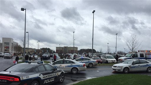 Authorities respond to the scene of a shooting at the Northlake Mall in Charlotte, N.C., Thursday, Dec. 24, 2015.