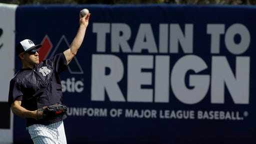New York Yankees' Jacoby Ellsbury throws in the outfield during a spring training baseball workout Thursday, Feb. 25, 2016, in Tampa, Fla. (AP Photo/Chris O'Meara)