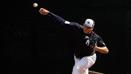 New York Yankees relief pitcher Dellin Betances throws in the bullpen before a spring training baseball game against the Boston Red Sox Saturday, March 5, 2016, in Tampa, Fla. (AP Photo/Chris O'Meara)