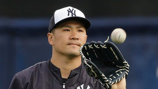 New York Yankees pitcher Masahiro Tanaka, of Japan, catches the ball during a spring training baseball workout Wednesday, Feb. 24, 2016, in Tampa, Fla. (AP Photo/Chris O'Meara)