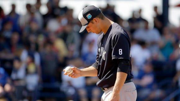 New York Yankees pitcher James Kaprielian pauses on