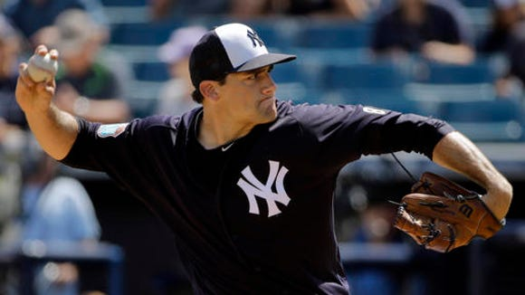 New York Yankees starting pitcher Nathan Eovaldi delivers to the Toronto Blue Jays during the first inning of a spring training baseball game Thursday, March 10, 2016, in Tampa, Fla. (AP Photo/Chris O'Meara)