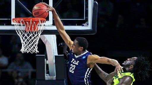 Yale forward Justin Sears (22) slams a dunk as he gets past Baylor forward Taurean Prince (21)