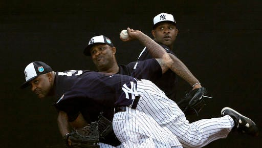New York Yankees starting pitcher CC Sabathia, shown in this multiple exposure photo, throws in a bullpen session before a spring training baseball game against the St. Louis Cardinals Thursday, March 31, 2016, in Tampa, Fla.