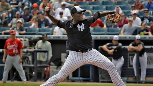 New York Yankees starting pitcher Michael Pineda throws against the St. Louis Cardinals during the first inning of a spring training baseball game Thursday, March 31, 2016, in Tampa, Fla.