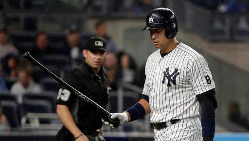 New York Yankees designated hitter Alex Rodriguez walks back to the dugout after popping out against the Tampa Bay Rays during the sixth inning of a baseball game, Friday, April 22, 2016, in New York.