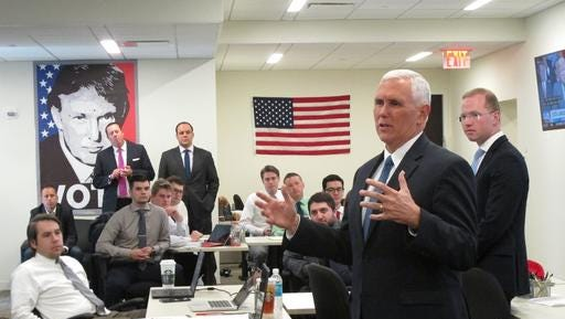 In this photo taken Sept. 15, 2016, Republican vice presidential candidate, Indiana Gov, Mike Pence gives a pep talk to campaign staff and volunteers inside Trump Tower in New York. (AP Photo/Scott Bauer).