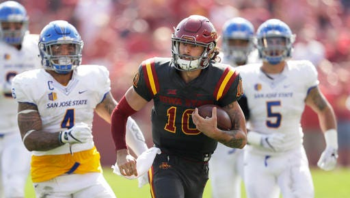 Iowa State quarterback Jacob Park (10) runs from San Jose State linebacker Christian Tago, left, and linebacker Frank Ginda, right, on Saturday in Ames.