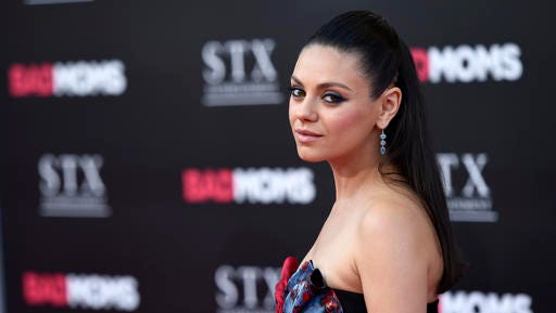 "FILE - In this July 26, 2016 file photo, Mila Kunis, a cast member in ""Bad Moms,"" poses at the premiere of the film at the Mann Village Theatre in Los Angeles. Kunis says in a new essay that anytime she experiences gender bias at work, she's going to speak up about it. The 33-year-old actress-producer says in the essay published Thursday, Nov. 3, 2016, that women have been conditioned to believe that their livelihoods might be threatened if they speak out against sexist behavior."