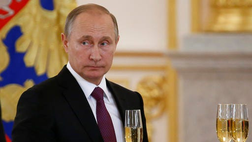 In this Nov. 9, 2016, photo, Russian President Vladimir Putin makes a toast during a ceremony for receiving diplomatic credentials from foreign ambassadors in the Kremlin in Moscow, Russia. In careful phrasing befitting the spy he once was, Vladimir Putin has made it clear he expects a great deal from President-elect Donald Trump. And, the billionaire businessman may expect a transactional relationship with Putin.